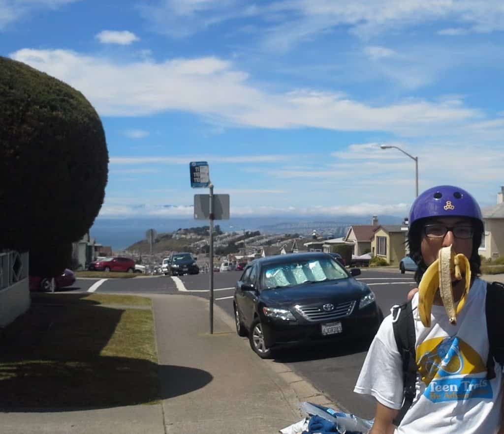 Eating bananas with Teen Treks while stopping for a snack break while bicycling along the beautiful California Coast.
