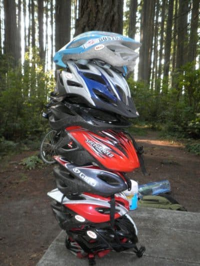 Fun with stacking helmets while camping on a Teen Treks summer adventure.