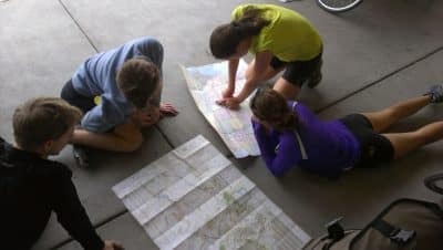 Checking the map on a Teen Treks summer bicycle tour.